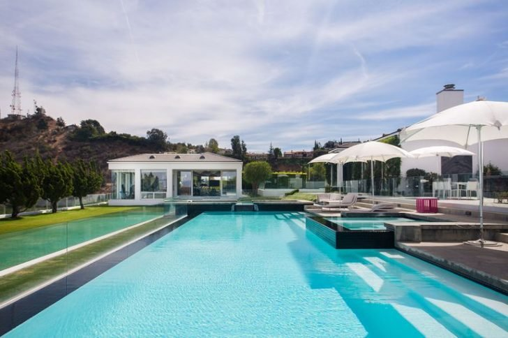 The full sized tennis court and infinity pool are the highlights of this expansive property.
