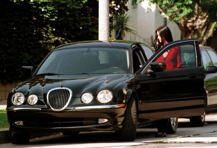Cox loves showing off her monstrous Jaguar S-Type as she drives on roads and highways.